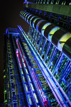 A shot of the Lloyds Building looking up into the night sky